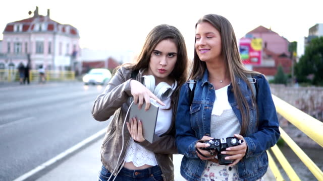 best friends, young girls walking and sightseeing in the city. - pointing stock videos & royalty-free footage