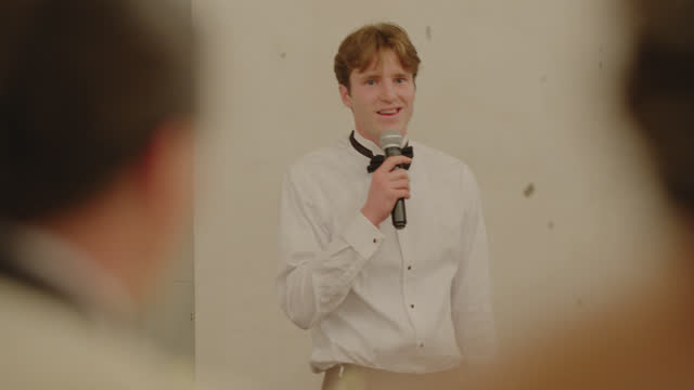 best man gives a heartfelt toast to the bride and groom during dinner - speech stock videos & royalty-free footage