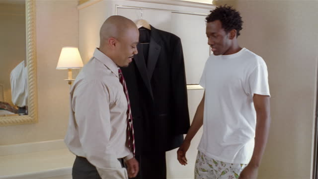best man visiting groom getting dressed on morning of wedding day / laughing at groom's boxer shorts - boxer shorts stock videos and b-roll footage