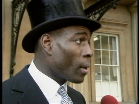 Best of 1990 Collection T15029009 1521990 Boxer Frank Bruno receives MBE London Buckingham Palace Frank Bruno wearing top hat and suit inside grounds...
