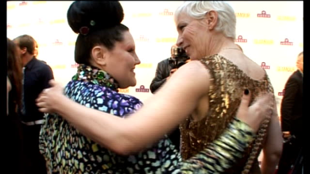 Beth Ditto posing for photocall with Annie Lennox