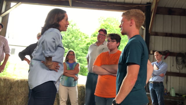 beth jordan and her husband farmer justin jordan talk with democratic presidential candidate us sen kamala harris in a barn at the coyote run farm on... - presidential candidate stock videos & royalty-free footage