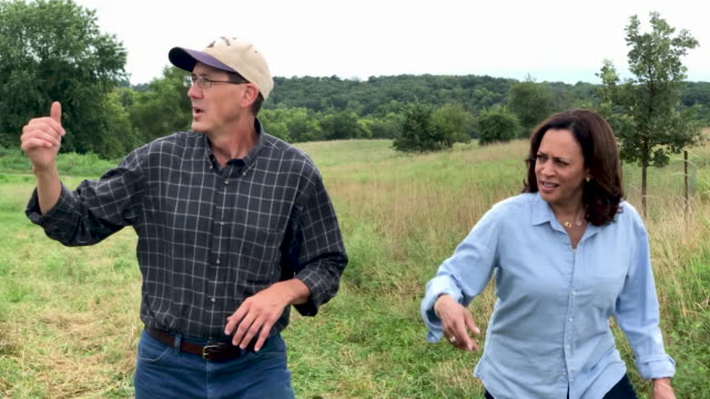 beth jordan and her husband farmer justin jordan talk with democratic presidential candidate u.s. sen. kamala harris in a barn at the coyote run farm... - husband stock videos & royalty-free footage