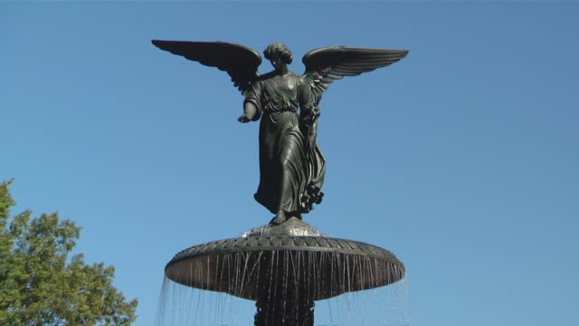 of bethesda fountain, bethesda fountain, tourist snapping photos at the bottom of the bethesda terrace steps, people riding bikes, people running,... - snapping stock videos & royalty-free footage