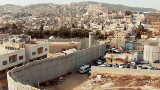 bethlehem, palestine separated by the west bank barrier - view from above. - apartheid stock videos and b-roll footage