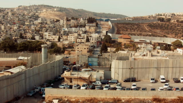 bethlehem, palestine separated by the west bank barrier - view from above. - apartheid stock videos & royalty-free footage