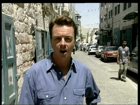 bethlehem returned to palestinian control itn i/c irvine along into church of the nativity few people along thru empty church azmi juha interviewed... - church of the nativity stock videos and b-roll footage