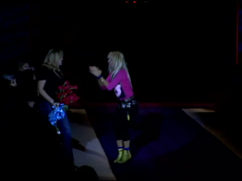 stockvideo's en b-roll-footage met betsey johnson doing a cartwheel at the end of her show at the olympus fashion week fall 2006 betsey johnson backstage and runway at the promenade... - dameskleding