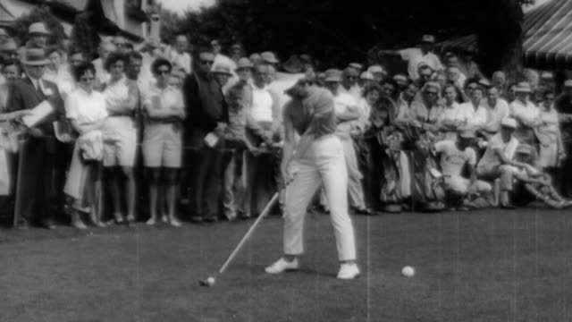 betsy rawls strikes golf ball with club as crowd watch from behind / marlene bauer hagge hits the ball / joyce zisk hits a gold ball with her club /... - holing stock videos & royalty-free footage