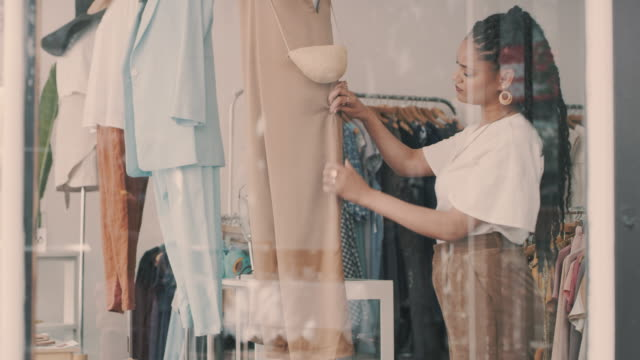 better buys yours before they sell out - clothes shop stock videos & royalty-free footage