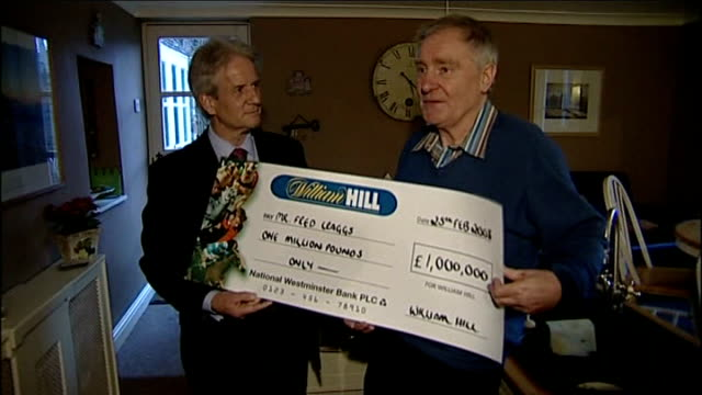 first betting shop millionaire collects his winnings nr thirsk int fred craggs posing with his winning cheque - winnings stock videos and b-roll footage
