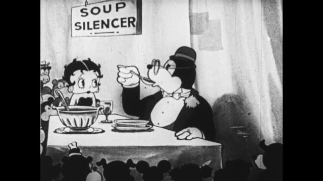 Betty Boop and friend demonstrate a soup silencer at Big Invention Show