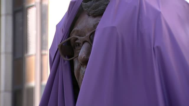 statue of wales' first black headteacher unveiled; wales: cardiff: central square: ext various shots of a crowd of people gathered to celebrate the... - purple stock videos & royalty-free footage