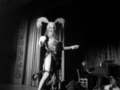 betty grable dancing performing on stage while wearing revealing showgirl outfit and holding fan / betty grable performing buddy rich playing drums... - burlesque stock videos & royalty-free footage
