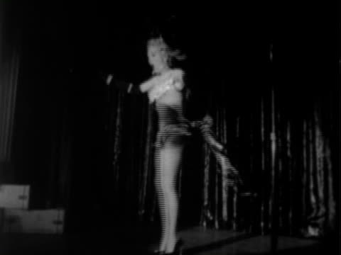 betty grable wearing revealing showgirl outfit while singing and dancing on stage with male dancers / tilting ms of famous legs of betty grable while... - burlesque stock videos & royalty-free footage