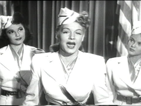 """betty hutton and two adult caucasian female dancers in white military type uniform dresses performing uso song """"plain jane doe""""; hutton and dancers... - the dominion theatre stock videos & royalty-free footage"""