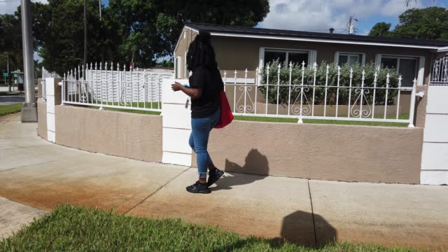 bettylourde guerrier canvasses a neighborhood encouraging people to vote for democratic presidential nominee joe biden, who is running against... - nominee stock videos & royalty-free footage