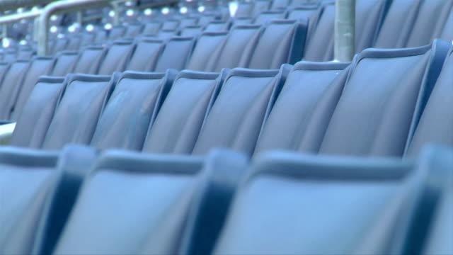 Between rows of empty blue seats at Yankee Stadium ballpark NYC NY Yankees Bronx Bombers MLB baseball