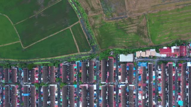 vídeos y material grabado en eventos de stock de entre la ciudad y la vista aérea del paisaje del campo de arroz - the nature conservancy