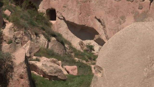 between two rocks, cappadocia, turkey - cliff dwelling stock videos & royalty-free footage