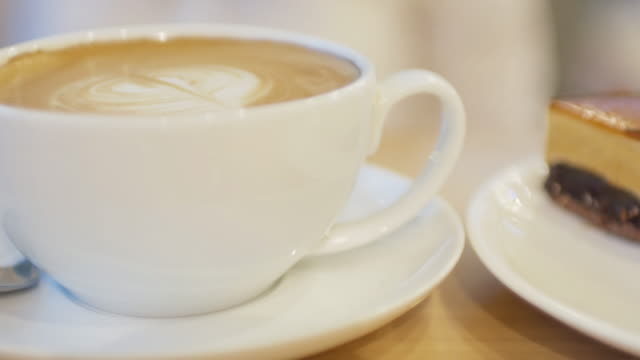 beverage coffee and cake for relax time and break time - froth art stock videos and b-roll footage
