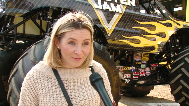 beverley mitchell on tell us who are you here with today and what are you looking forward to seeing at monster jam, on which truck is your favorite... - angel stadium stock videos & royalty-free footage