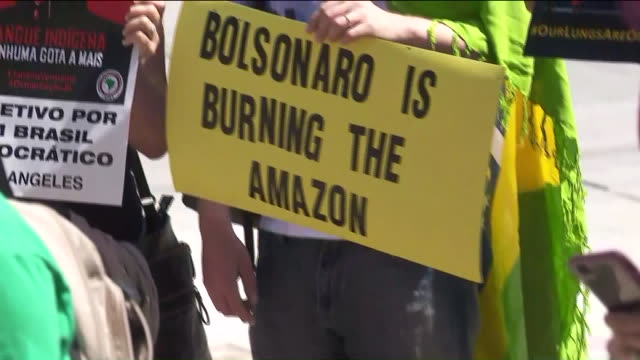 stockvideo's en b-roll-footage met ktla beverly hills ca us activists gathering in front of the brazilian consulate building to hold the government accountable for it's role in the... - trust