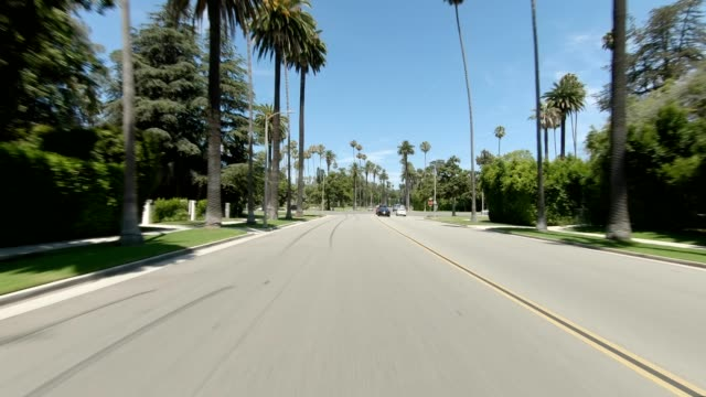 beverly hills ii synced series rear view driving process plate - moving process plate stock videos & royalty-free footage