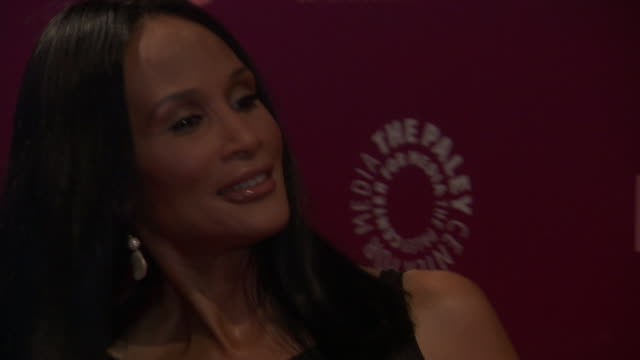 Beverly Johnson posing for paparazzi on the red carpet at the Paley Center of Media