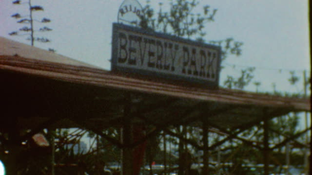 beverly park signage / locomotive / mini cadillac / merry go round / horse and buggy ride / beverly park memories at amusement park on may 07 1966 in... - cadillac stock videos & royalty-free footage