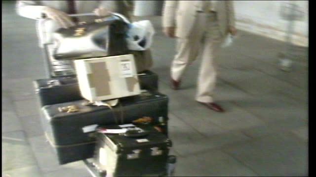 stockvideo's en b-roll-footage met british eye specialists arrive in delhi india delhi ext ms mr malcolm kerrmuir and mr alan johns towards at airport ms both out of airport towards... - bhopal