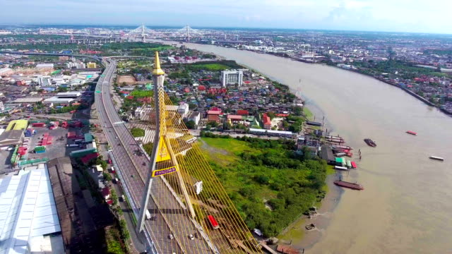 Bhumibol bridge and traffic in Bangkok, Thailand, Flying over Suspension Bridge with Drone