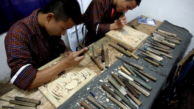 vídeos y material grabado en eventos de stock de bhutan, thimphu, the royal academy of performing arts - camisa a cuadros
