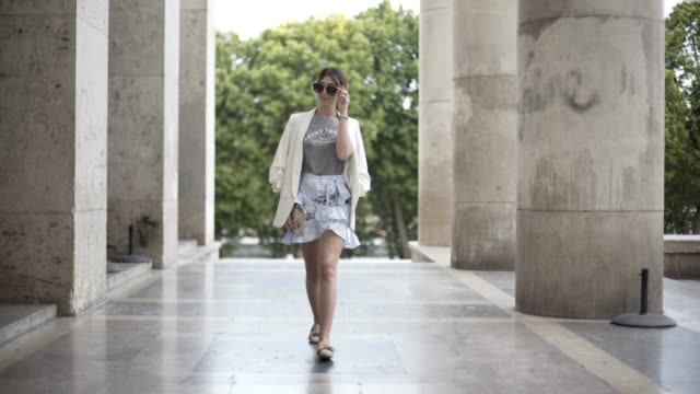 bianca derhy, fashion blogger bibi goes chic, wears a shein flower print skirt, a river island gray top with the inscription 'saint tropez', a zara... - gray jacket stock videos & royalty-free footage