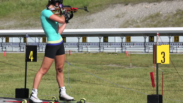 biathalon racers train at nordic center - biathlon stock videos and b-roll footage