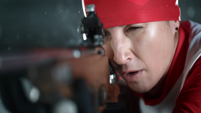 SLO MO biathlete eye on the target and shooting
