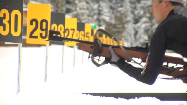 cu biathlete shooting at target, nordic park, callaghan valley, whistler, british columbia, canada - biathlon stock videos and b-roll footage