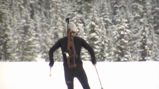 slo mo ws biathlete skiing, nordic park, callaghan valley, whistler, british columbia, canada - biathlon stock videos and b-roll footage