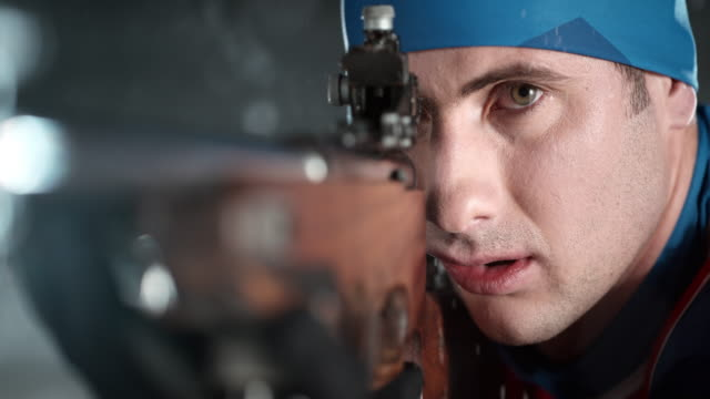 slo mo biathlete's eye on the target and making the shot - biathlon stock videos and b-roll footage