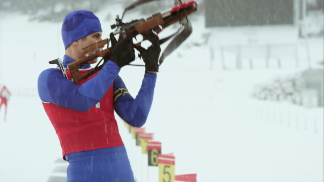biathlon athlete shooting in standing position - biathlon stock videos and b-roll footage
