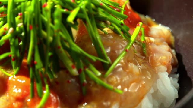'bibimbap' (mixed rice with various ingredients) with soy sauce 'gejang' (marinated crab) - krabba bildbanksvideor och videomaterial från bakom kulisserna