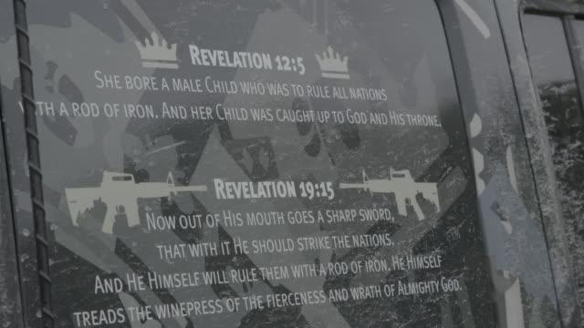 bible revelations on unification church member van, medium shot - nuovo testamento video stock e b–roll