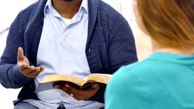 bible study teacher leads discussion group - bible stock videos & royalty-free footage