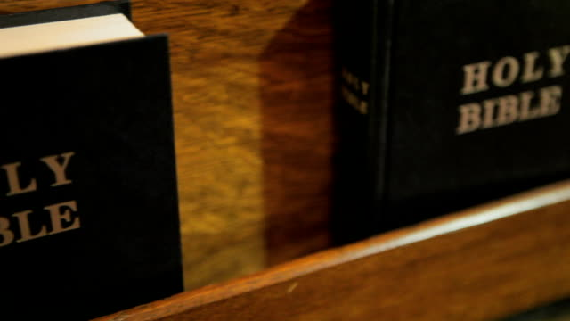 bibles in church pew - theology stock videos and b-roll footage