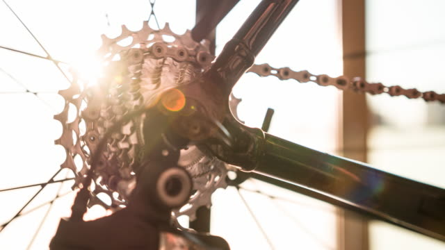 bicycle gear and chain in motion at sunrise - endurance stock videos and b-roll footage