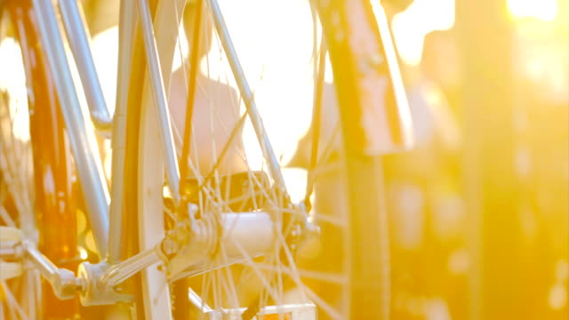 bicycle in the city street at summer sunset. - wheel stock videos & royalty-free footage