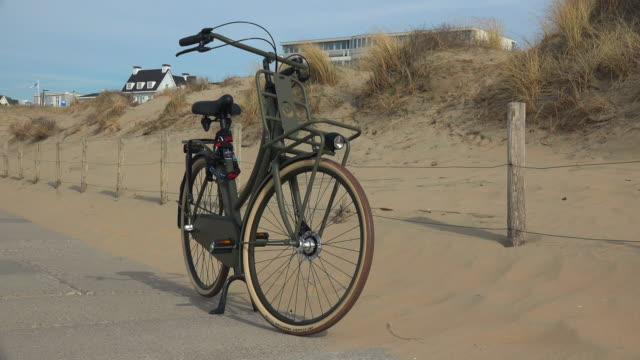 bicycle in the dunes of noordwijk, south holland, netherlands - sand dune stock videos & royalty-free footage
