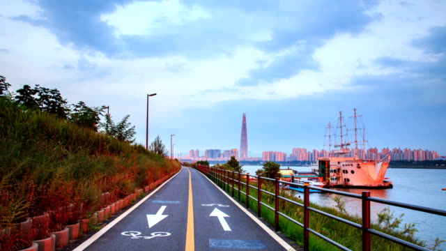 Bicycle Lane in Seoul Ttukseom and Lotte World Tower in the distance (Lotte World Tower is one of the tallest building in Korea)