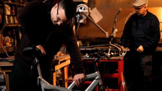 bicycle mechanic - repairing stock videos & royalty-free footage