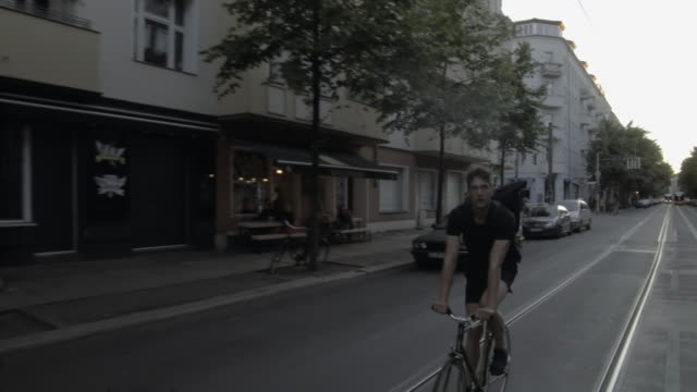bicycle messenger riding through berlin - young men stock videos & royalty-free footage